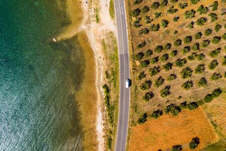 Panoramic view on road next to Adriatic sea, in Dalmatia, Croatia, view from drone