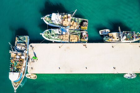 Aerial overhead view of fishing ships in town of Biograd na Moru, Croatia