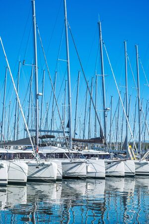 Many yachts and sailboats anchored in raw in marina in town of Biograd na Moru, Adriatic sea in Croatia