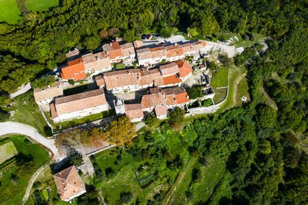 Old town of Hum on the hill, beautiful traditional architecture in Istria, Croatia, aerial view from drone Stock fotó