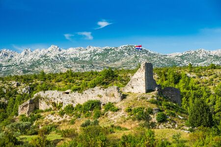 Ruins od old fortress over the town of Obrovac in Croatia, Velebit mountain in background