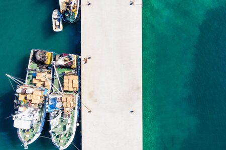 Aerial overhead view of fishing ships in town of Biograd na Moru, Croatia