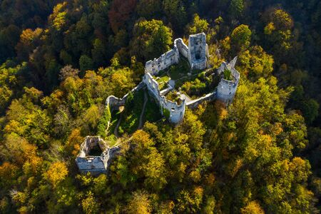 Croatia, Samobor, old abandoned medieval fortress ruins and forest mountain landscape aerial overhead view from drone in autumn