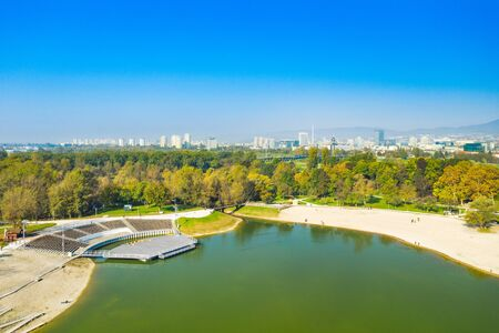 Beautiful lake Bundek in park in autumn in Zagreb, Croatia, aerial view from drone