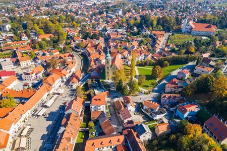 Croatia, aerial view of town of Samobor, main square, church tower and red roofs from drone