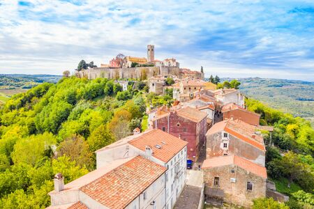 Old town of Motovun on the hill, beautiful architecture in Istria, Croatia, aerial view from drone Stock fotó