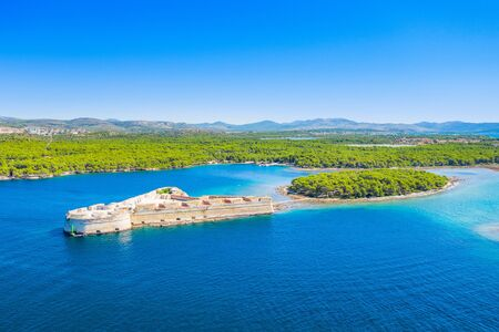 Old stone St. Nicholas fortress at Sibenik bay entrance, archipelago of Dalmatia, Croatia, drone aerial shot