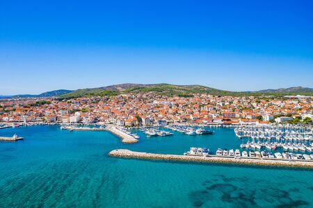 Town of Vodice and amazing turquoise coastline on Adriatic coast, aerial view, Croatia