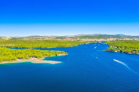 Panoramic view of the Sibenik channel bay entrance, archipelago in Dalmatia, Croatia, drone aerial shot, beautiful seascape
