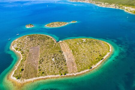 Croatia, Adriatic sea, aerial drone view of the amazing heart shaped island of Galesnjak, beautiful coastline