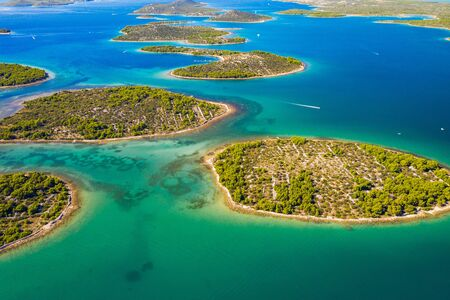 Wonderful Croatian coastline, small Mediterranean stone islands in Murter archipelago, aerial view of turquoise bays from drone