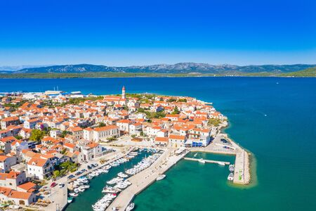 Croatia, Island of Murter, beautiful old traditional coastal town of Betina on Adriatic sea, drone aerial