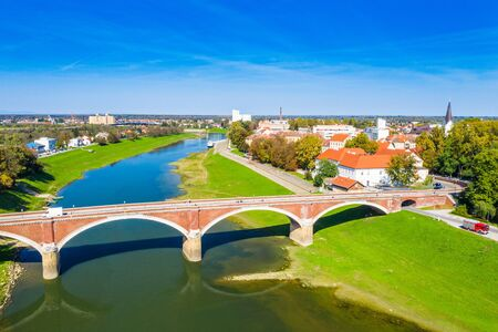 Croatia, town of Sisak, aerial view from drone of the old town center and bridge over Kupa river