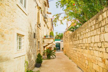 Croatia, Dalmatia, beautiful old street and traditional houses in the old historical town of Trogir