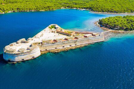 Saint Nicholas fortress at Sibenik bay entrance, Dalmatia, Croatia, drone aerial shot of beautiful blue seascape