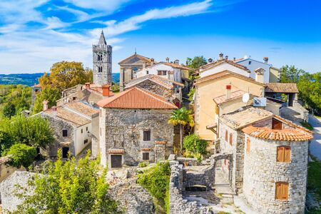 Beautiful old town of Hum, stone houses and church tower bell, romantic traditional architecture in Istria, Croatia, aerial view from drone
