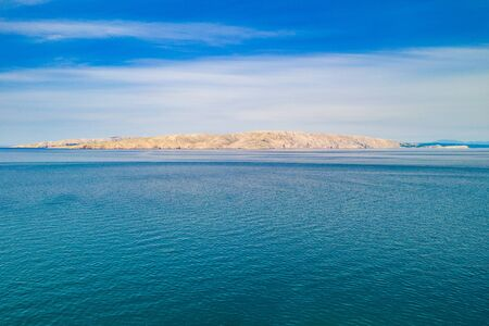 Croatia, Adriatic landscape, rocky Rab island and peaceful seascape in the morning, view from distance Stok Fotoğraf - 148181856