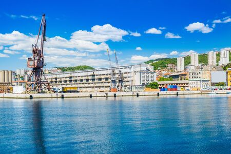Waterfront view and old cranes in harbor in the city of Rijeka, Croatia.
