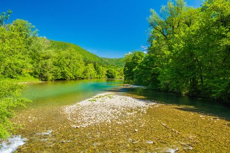 Croatia, beautiful landscape in spring, canyon of Kupa river in Gorski kotar, mountains in background