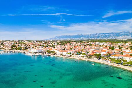 Croatia, beautiful Adriatic coastline, town of Novalja on the island of Pag, city center and marina aerial view from drone
