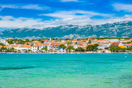 Croatia, town of Novalja on the island of Pag, marina and turquoise sea in foreground, tourist destination on Adriatic sea Stock fotó