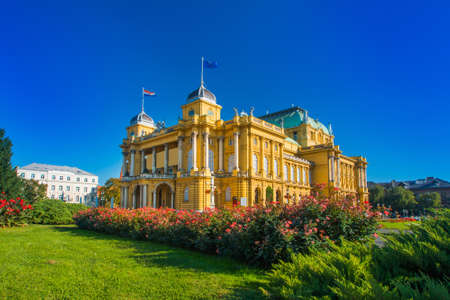 Croatian national theater building and flowers in park in Zagreb, Croatia