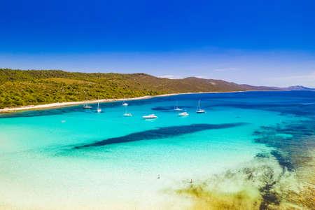 Beautiful Croatia. Aerial view of azure turquoise lagoon on Sakarun beach on Dugi Otok island, Croatia, yachts anchored in clear sea water.