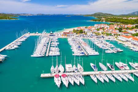 Croatia, town of Pirovac, panoramic view of marina with sailboats on beautiful blue Adriatic seascape