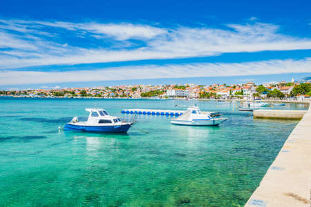 Croatia, town of Novalja on the island of Pag, marina and turquoise sea with boats in foreground Stock fotó