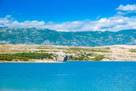 Croatia, Adriatic island of Pag, sea shore and Velebit mountain in background