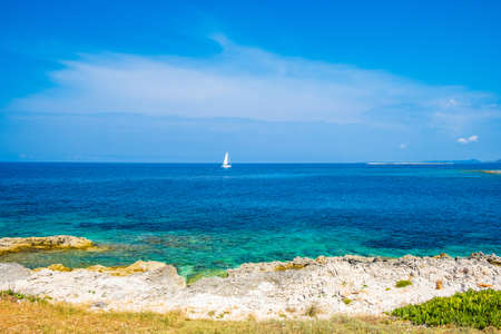 Beautiful seascape on Adriatic sea in Croatia, Dugi otok island, sailing boat on sea in bay on Veli Rat