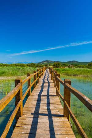 Wooden path in nature park Vrana lake (Vransko jezero), Dalmatia, Croatia, beautiful landscape in summer Stock fotó