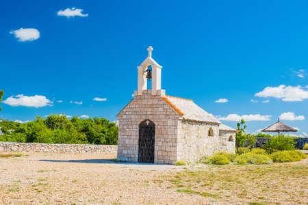 Croatia, mount Kamenjak on Vransko lake, beautiful old stone church on the hill, Mediterranean landscape Stock fotó