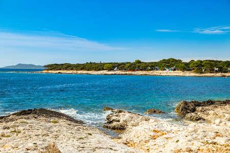 Beautiful blue bay on Adriatic sea in Croatia, Dugi Otok island, camping resort in Veli Rat pine forest