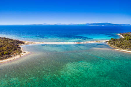 Amazing exotic islands with natural bridge in turquoise sea on the island of Dugi Otok on Adriatic sea in Croatia, drone aerial view