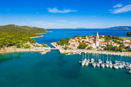 Beautiful old historic town of Osor, marina and bridge connecting islands Cres and Losinj, Croatia, aerial view from drone