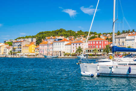 Seafront and sailboats in town of Mali Losinj on the island of Losinj, Adriatic coast in Croatia, popular touristic destination 免版税图像