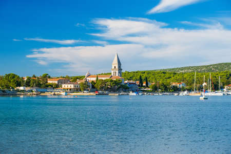 Old town of Osor between islands Cres and Losinj, Croatia, Adriatic seascape in foreground 免版税图像