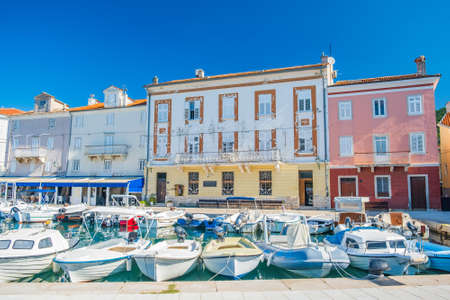 Boats in town of Cres, waterfront, Island of Cres, Kvarner, Adriatic sea in Croatia. Old renaissance buildings in background.