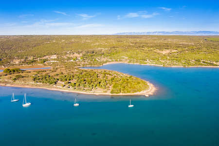 Aerial view of beautiful blue bay on Adriatic seascape paradise, sail boat in lagoon on the island of Losinj in Croatia