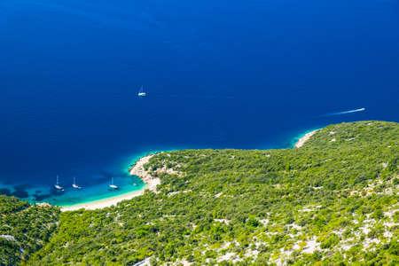 Croatia, amazing island of Cres on Adriatic coastline, aerial view of azure lagoon and beach under Lubenice town
