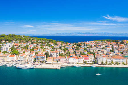 Aerial view of the seafront in town of Mali Losinj on the island of Losinj, Adriatic coast in Croatia, Velebit mountain in background
