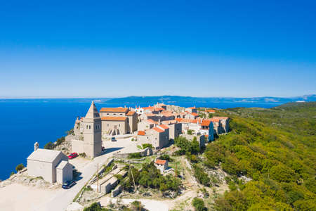 Amazing historical town of Lubenice on the high cliff, Cres island in Croatia, Adriatic sea in background 写真素材