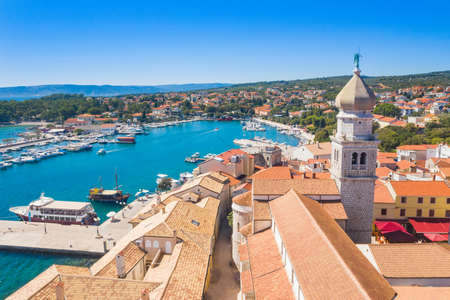 Aerial view of the old town of Krk in Croatia, cathedral tower and marina in background