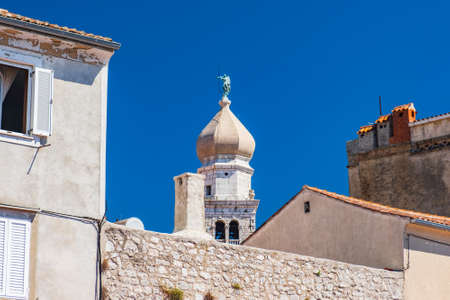 Cathedral tower bell and cityscape in Town of Krk in Croatia 写真素材