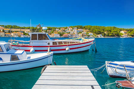 Boats on waterfront in town of Mali Losinj on the island of Losinj, Adriatic coast in Croatia