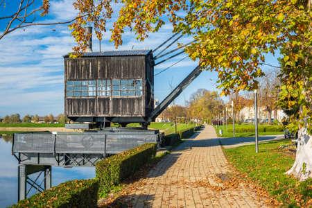Old steam crane on the river Kupa in Sisak, Croatia