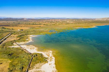 Ornithological nature park, shore of Vrana lake (Vransko jezero) in Dalmatia, Croatia, drone aerial view