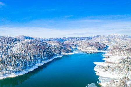 Beautiful showy winter landscape in Croatia. Panorama of Lokvarsko lake and in Gorski kotar from drone. Foto de archivo