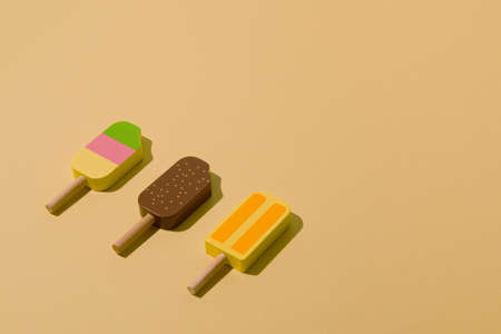Colorful sunlit ice cream on a pale yellow background. Minimal ice cream layout.